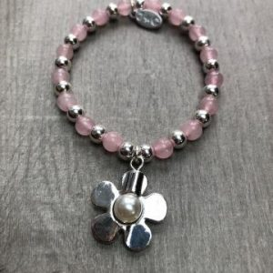 Pink beaded bracelet with Daisy charm